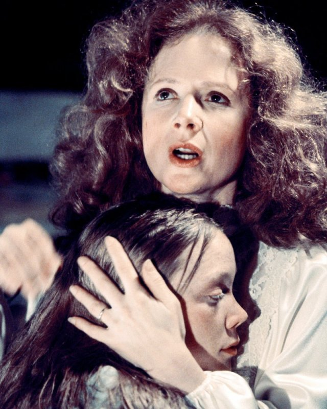 Margaret White about to stab Carrie in the back